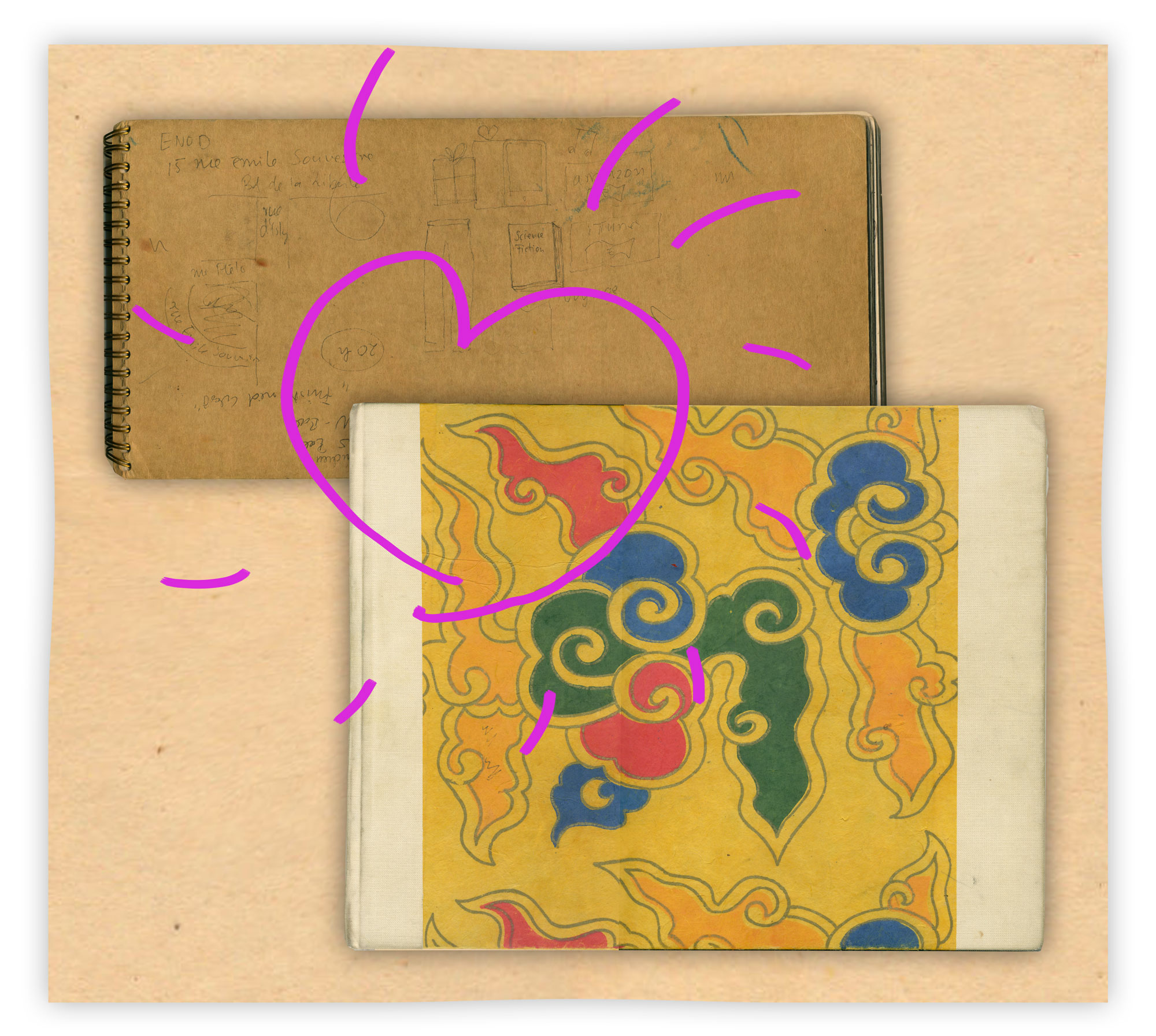 zwei Skizzenbücher liegen auf dem Tisch. Darüber ist ein pinkes Herz gezeichnet.